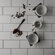20-inch x 20-inch The Most Realistic Subway Tile Photography Backdrop 3 mm thick Physical Board, Lightweight, Moisture & Stain-Resistant with coffee cups and spoons