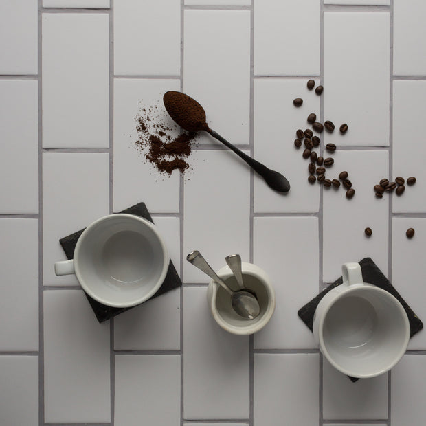 20-inch x 20-inch The Most Realistic Subway Tile Photography Backdrop 3 mm thick Physical Board, Lightweight, Moisture & Stain-Resistant with coffee cups, coffee creamer, and coffee beans