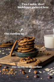 Super-Thin & Pliable Cookie Sheet Photography Backdrop 2 ft x 3 ft, Lightweight, Moisture & Stain-Resistant with cookies stacked and a glass of milk