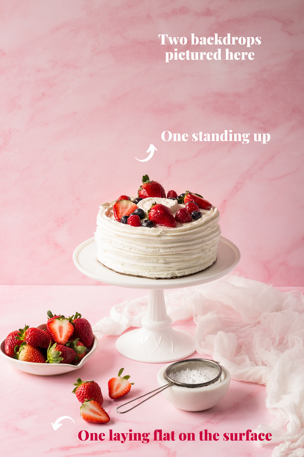 Super-Thin & Pliable Pink Marble Photography Backdrop 2 ft x 3 ft, Lightweight, Moisture & Stain-Resistant with a chantilly cake on a cake stand