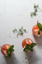 White Chipped Paint Photography Backdrop 2 ft x 3 ft | 3 mm thick and glasses of grapefruit juice, mint, and ice
