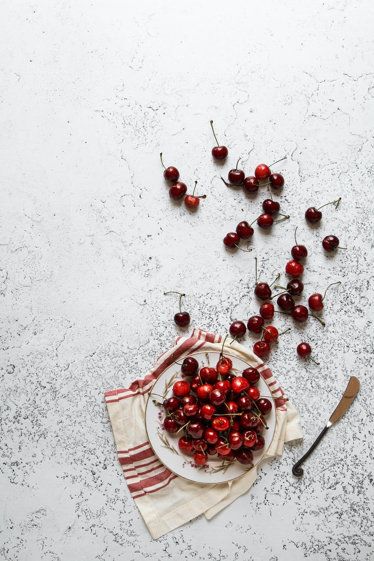 Super-Thin & Pliable White Plaster Photography Backdrop 2 ft x 3 ft, Lightweight, Moisture & Stain-Resistant with cherries