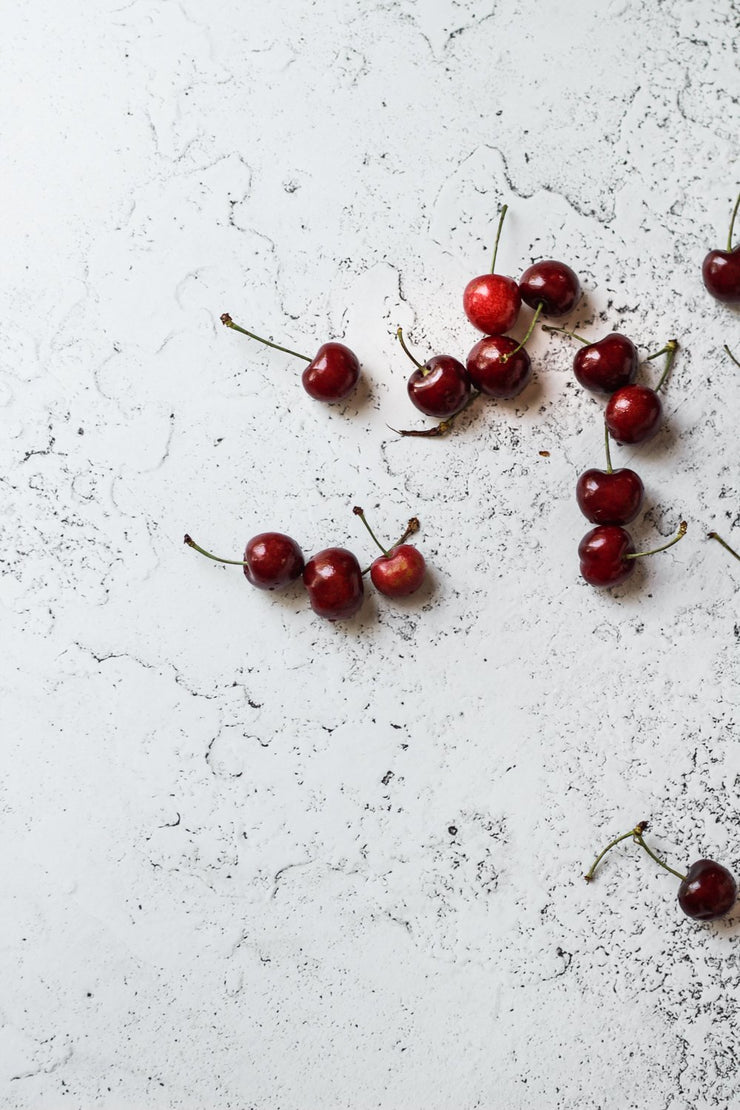 Super-Thin & Pliable White Plaster Photography Backdrop 2 ft x 3 ft, Lightweight, Moisture & Stain-Resistant and cherries up close