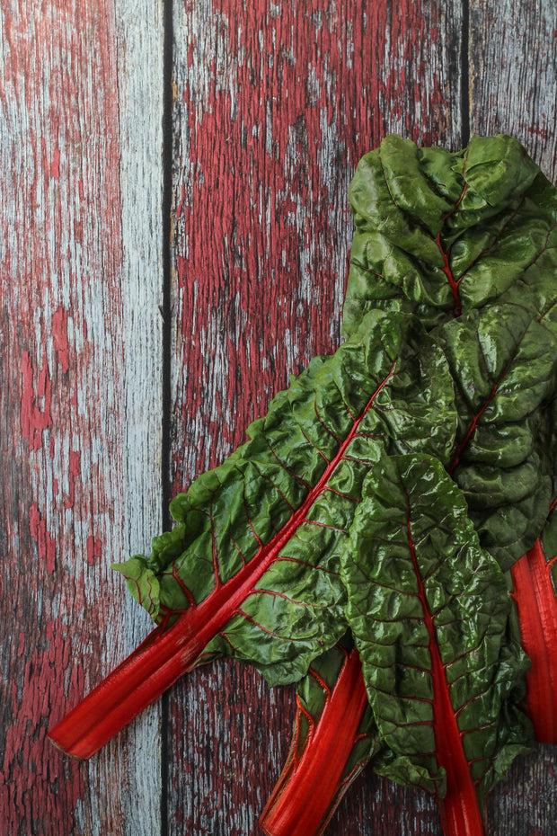 Aged Red Reclaimed Barn Wood Photography Backdrop 2 ft x 3ft board | 3 mm thick with Swiss chard up close