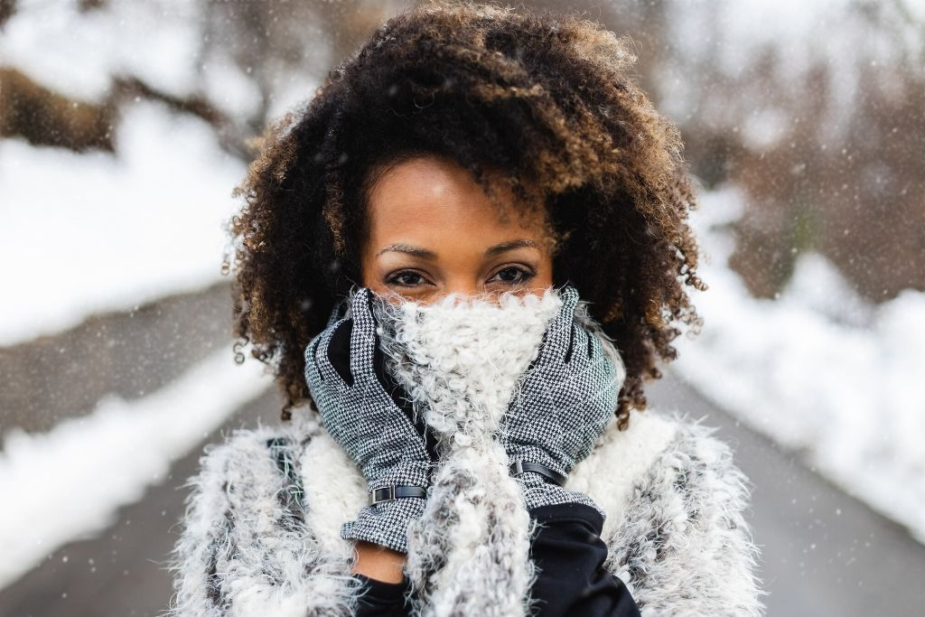 Woman with curly hair outside in winter