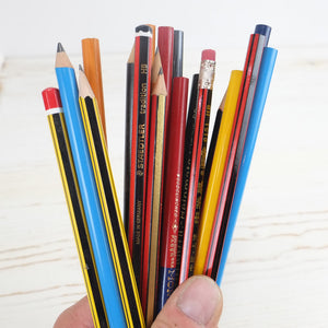 A collection of brightly colored vintage pencils