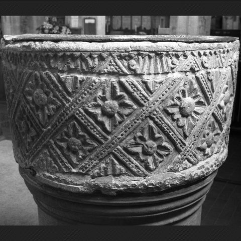 A photo as the Norman font looks today.