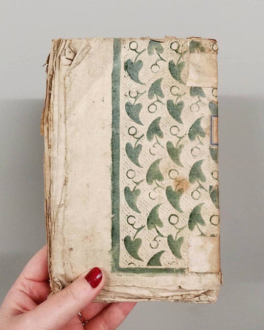 18th Century book with a similar pattern to the wallpaper example, with some differences. Photo courtesy of suives_le_fil via Instagram.