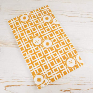 Japanese Camellia Block Printed Notebook Block Printed Notebook Papillon Papers Ochre Grid