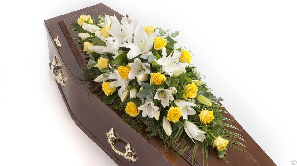 Rose and oriental lily casket spray