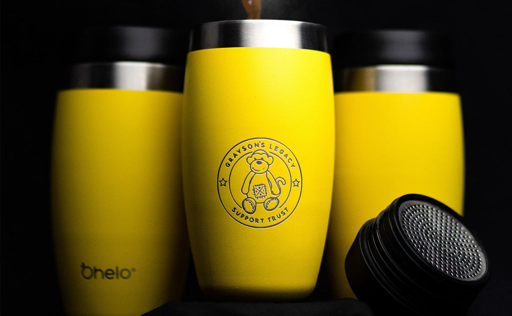 Ohelo yellow tumbler with large teddy logo for co-branding client
