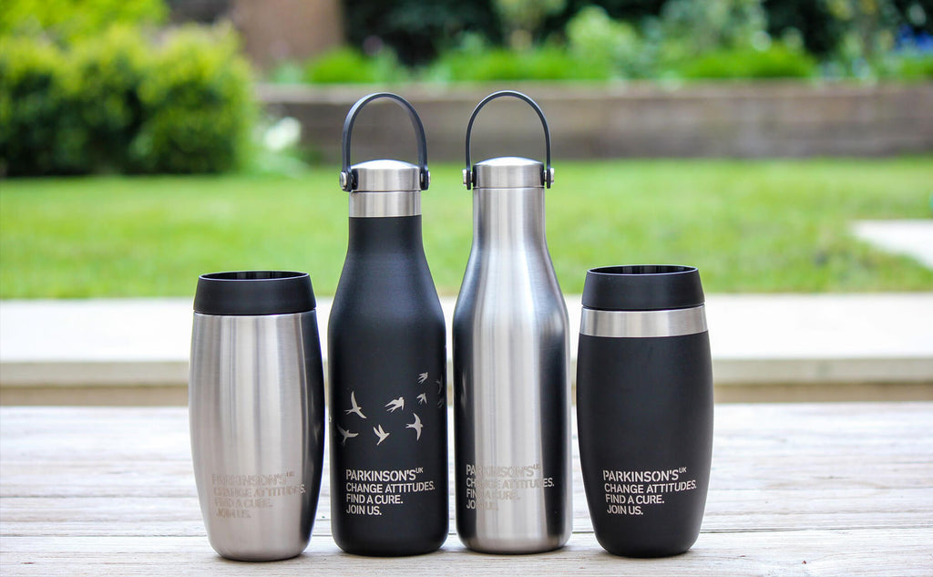 Ohelo black and steel bottles and tumblers co-branded with Parkinsons UK design