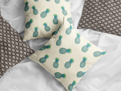 A pair of blue tropical pineapples accent pillows