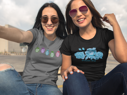 two smiling women wearing pono artworks tropical tees