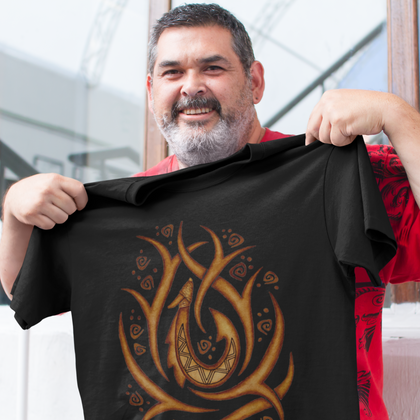 Smiling man holding up his new Hawaiian tribal fish hook t-shirt