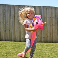 Girl riding on a Giant blow up Unicorn - Bloonimal