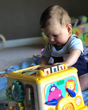 Baby boy playing with his activity bus shape sorter