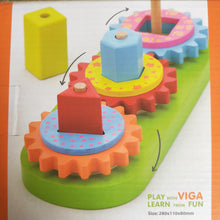 Stacking  gears puzzle - Stack the correct gear with the correct shape and turn to make all the wooden pieces spin