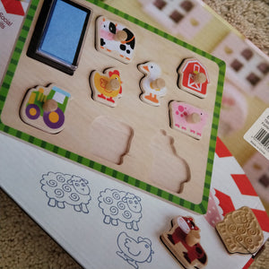 Wooden Puzzle and Stamp Farm set - Each peg puzzle has a animal rubber stamp and comes with ink pad