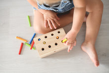 Load image into Gallery viewer, Girl playing with wooden worm catching game using magnetic stick to catch wooden coloured worms
