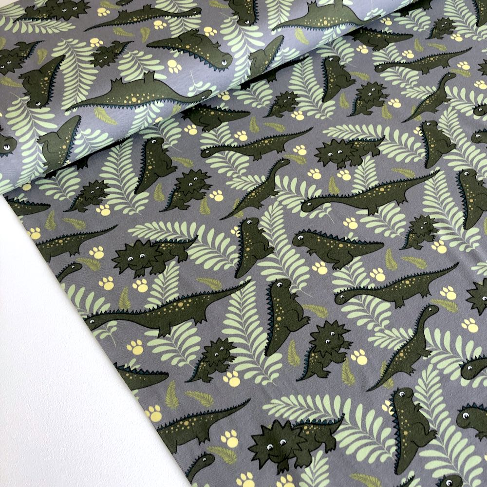 Cutie Dinos And Leaves Grey Jersey Print Fabric