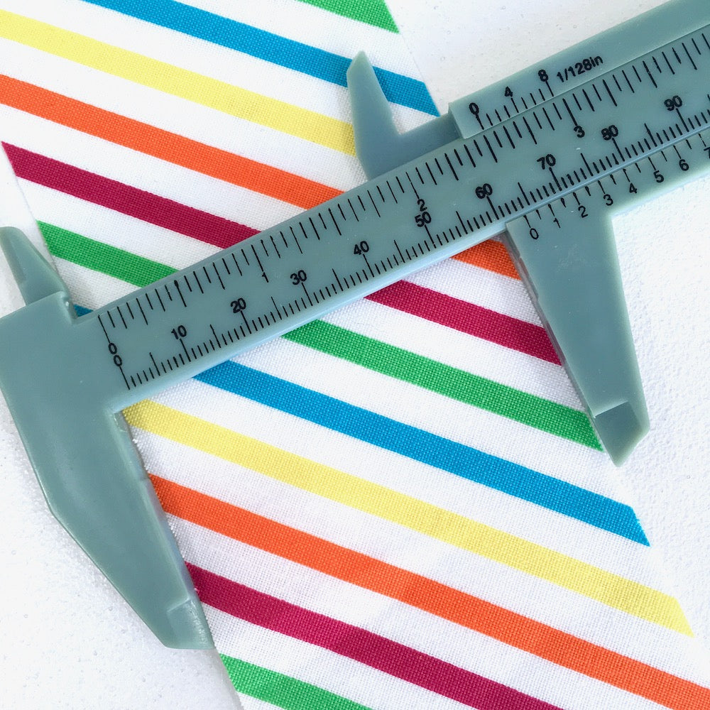 30mm Handmade Quilt Bias Binding - Rainbow Stripe Dino White