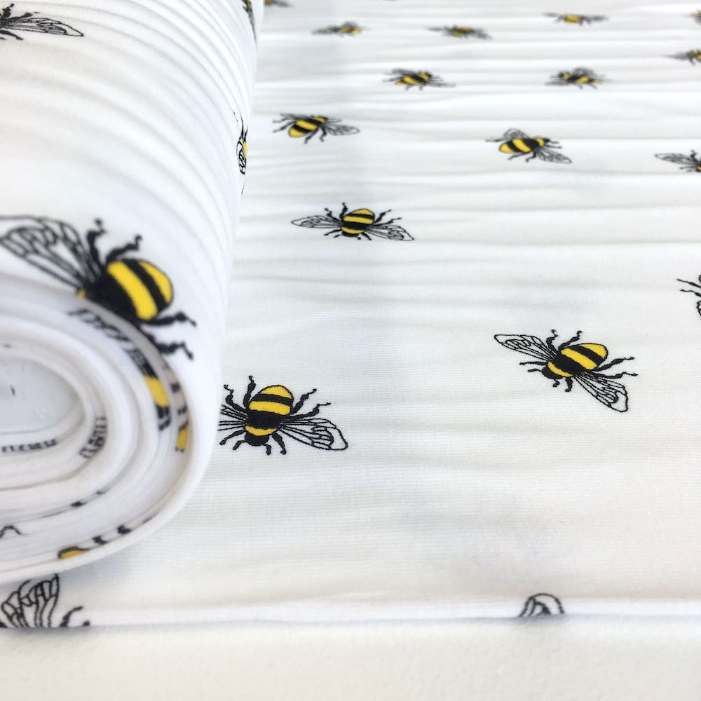 Scattered Bumble Bees White Jersey Print - Frumble Fabrics