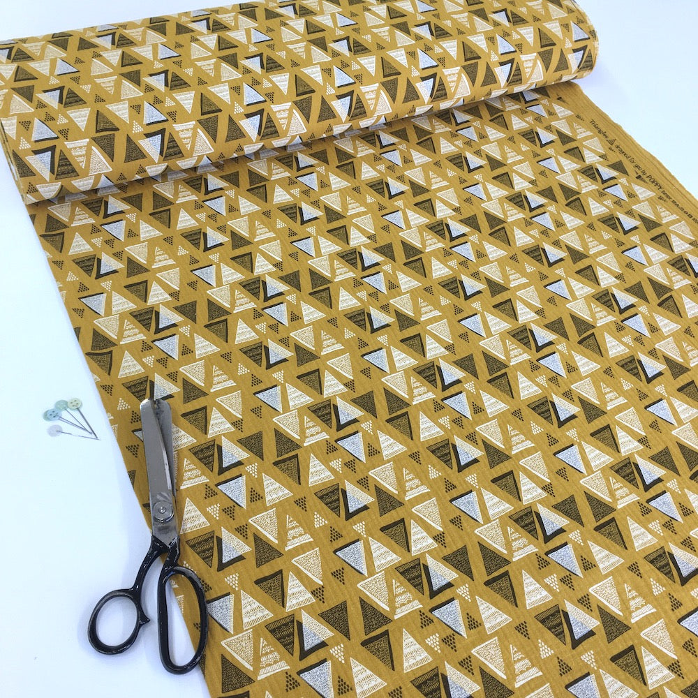 Triangle Stamps Double Gauze Mustard Fabric perfect for dressmaking or baby clothes