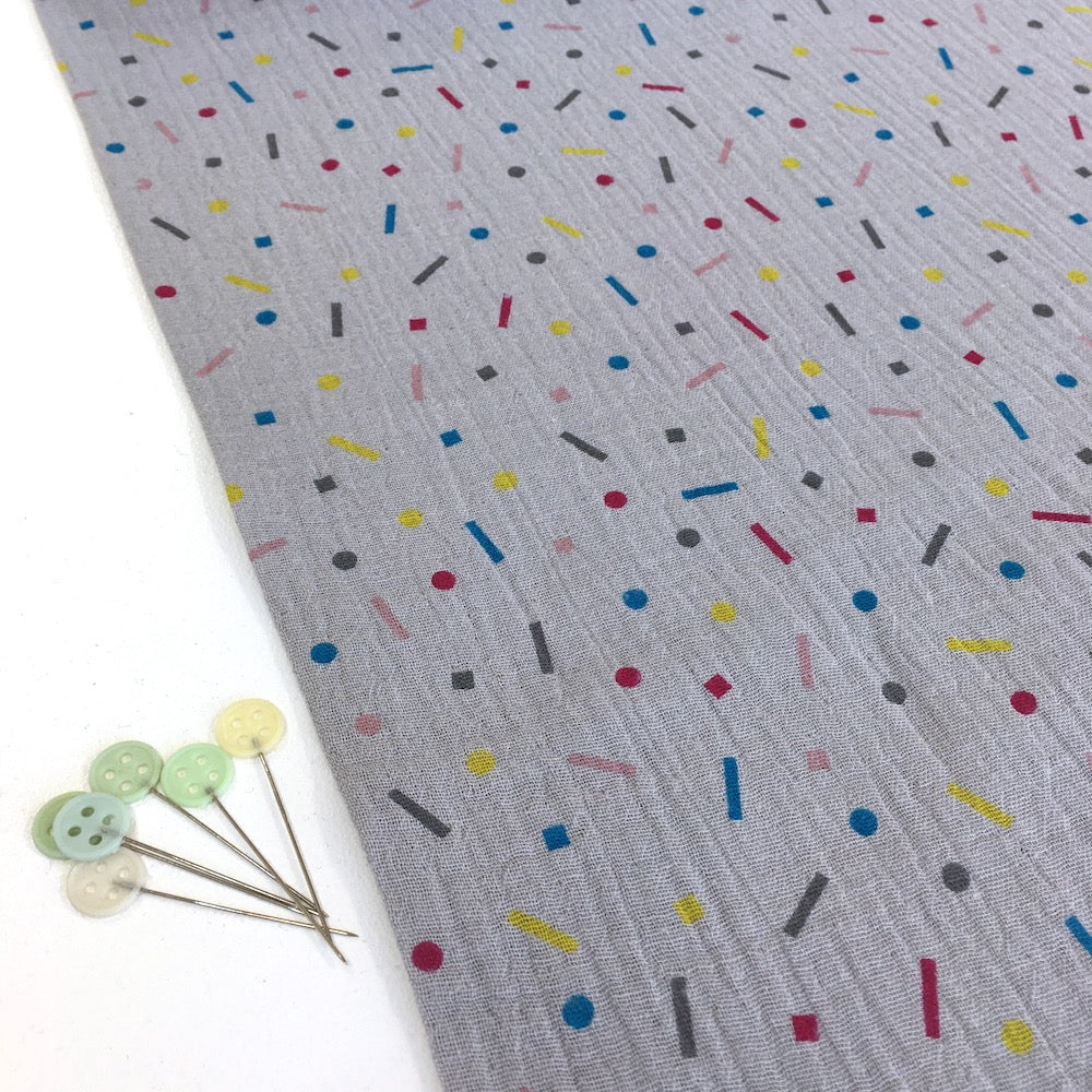 Rainbow Confetti Double Gauze Grey Fabric perfect for dressmaking and baby clothes