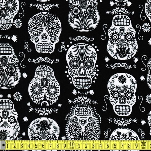 Folk Art Skulls Glow In The Dark Fabric by Timeless Treasures