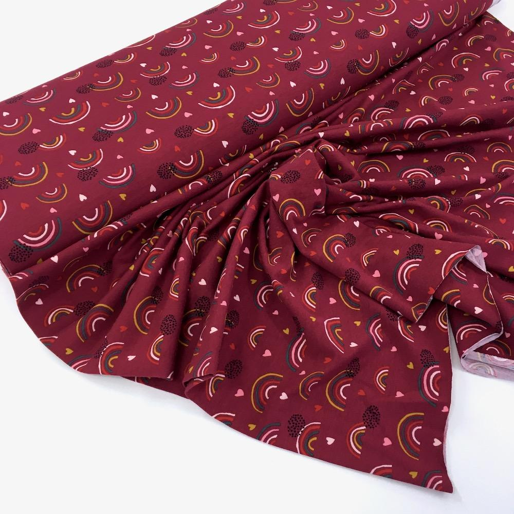 Organic Rainbows And Hearts Printed Jersey Plum - Frumble Fabrics