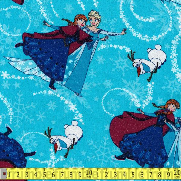 Frozen Sisters Ice Skating Toss Glitter Blue Fabric by Springs Creative