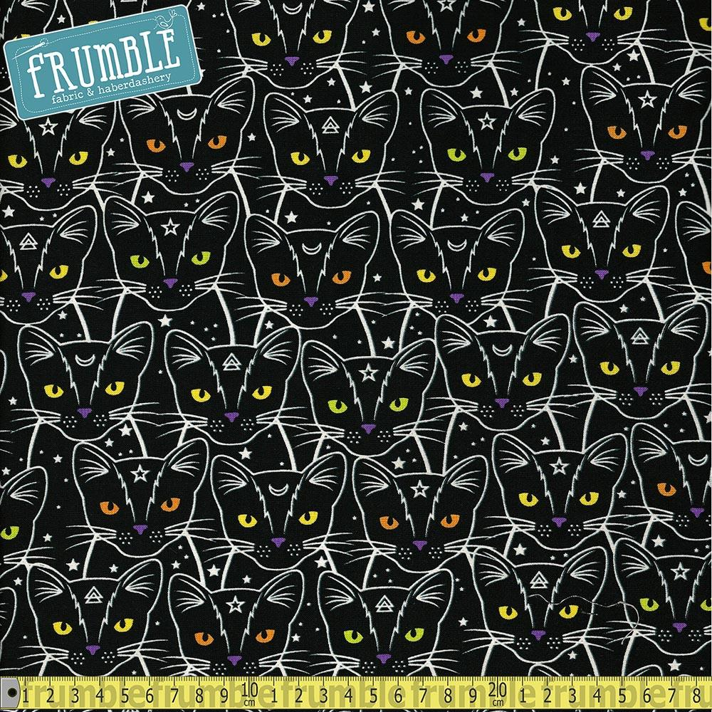 Glow In The Dark Star And Moon Cats Black Fabric by Timeless Treasures