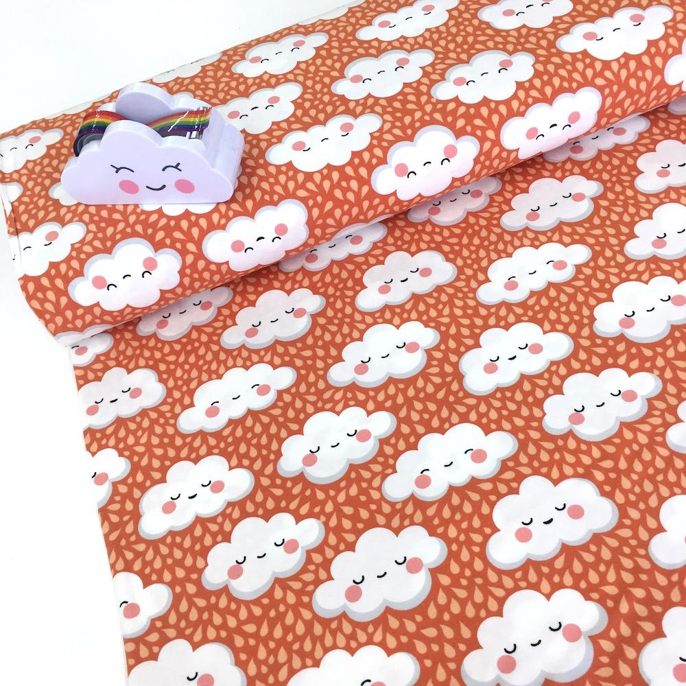 Cute Rain Clouds Printed Jersey Burnt Orange Fabric by Various