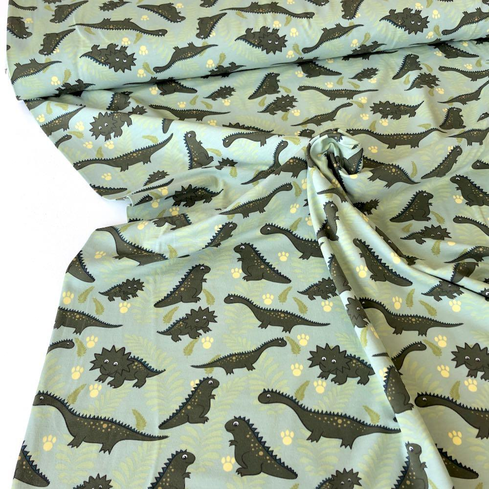 Cutie Dinos And Leaves Green Jersey Print - Frumble Fabrics