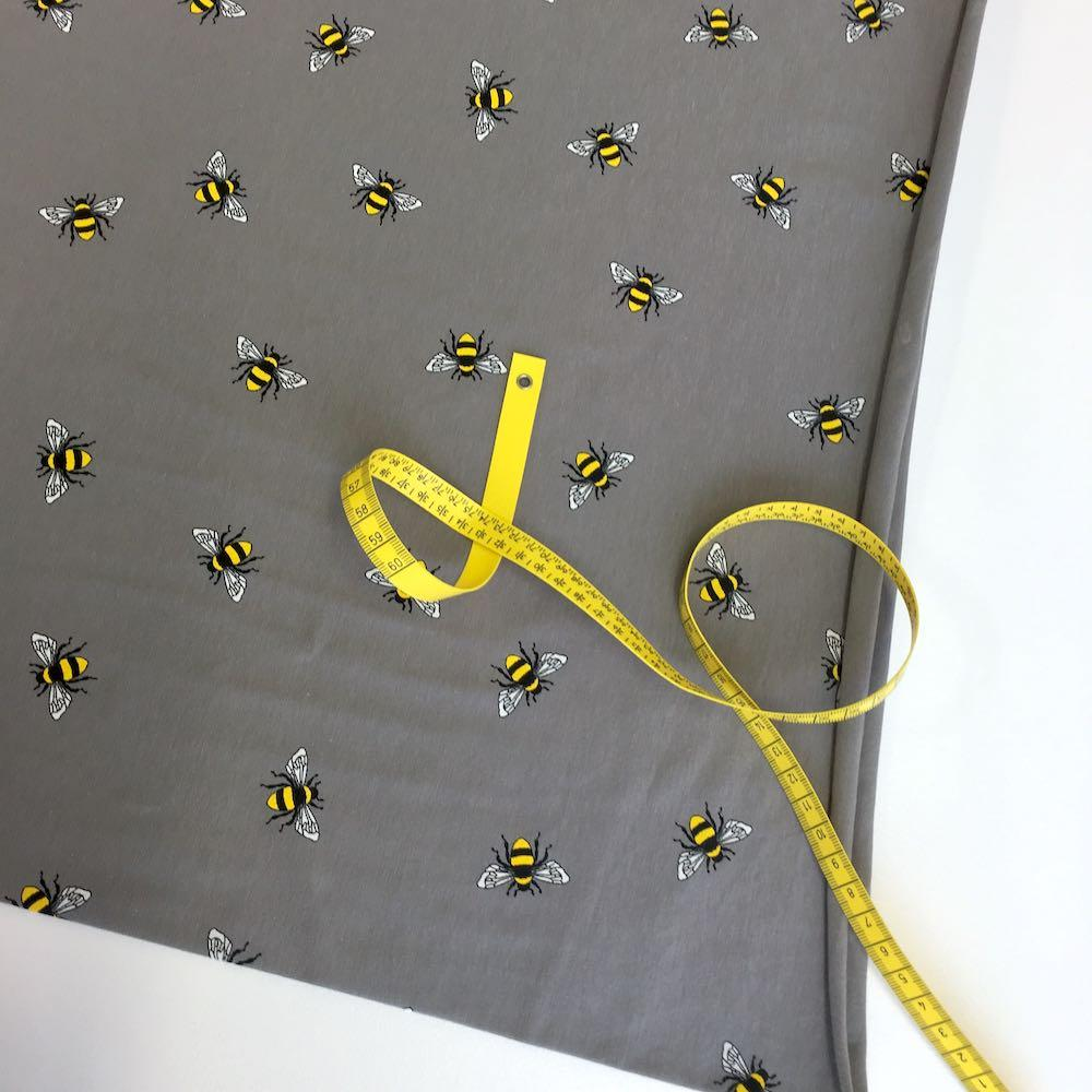 Scattered Bumble Bees Grey Jersey Print - Frumble Fabrics