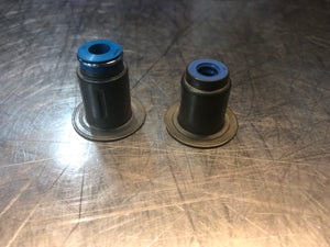 Factory style crimped valve seal on the left, our bonded seal on the right.  Under high boost/backpressure the factory style will blow the seal out of the body, Plus, our bonded seal allows for larger camshaft without worry of retainer to seal clearance issues.