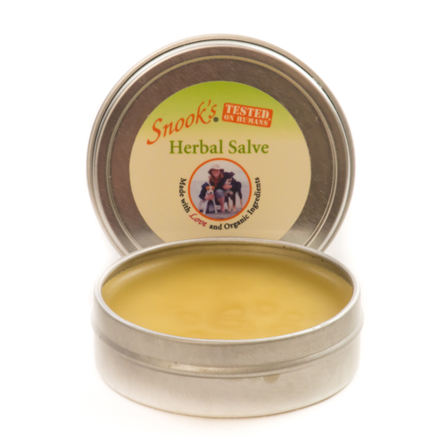 Herbal Salve made with Food Grade ingredients that can be used on hot spots, sores on pads and abrasions or bites.  Open tin shown