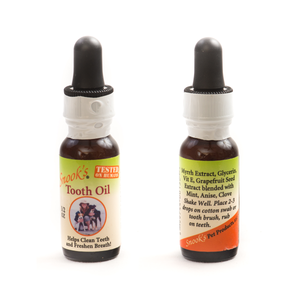 Snook's Tooth Oil 1/2oz bottle, front and back of bottle.