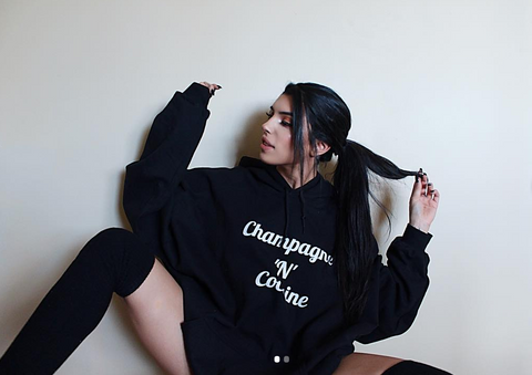 Picture of King Bekka wearing our Black Champagne N Cocaine oversized hoodie