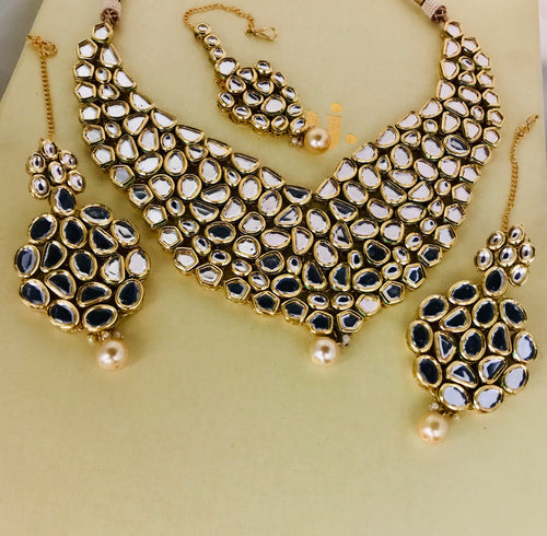 Gold and pearl kundan necklace earrings tikka set
