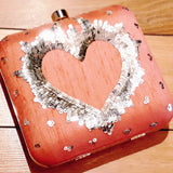 Embroidered clutch with a heart