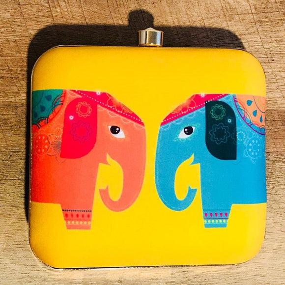 Yellow clutch with elephants