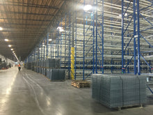 Load image into Gallery viewer, Wire mesh decks for pallet racking inside a large warehouse