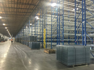 Wire mesh decks for pallet racking inside a large warehouse