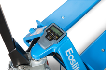 Load image into Gallery viewer, The digital scale on top of a manual hand pallet jack showing the weight in pounds and kilograms