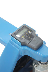 The integrated scale on a hand pallet truck showing the weight of a pallet on the forks