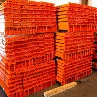 Pallet rack beams stacked neatly in a pile