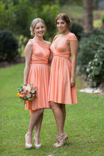 Load image into Gallery viewer, Apricot Wedding Bridesmaid Cocktail Convertible Wrap Multi-way Dress Lucy and Loo Style and Scents