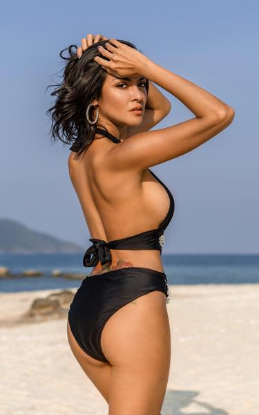 waist cut out swimsuit on model side view